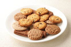 Oven fresh cookies and biscuits served in plate..