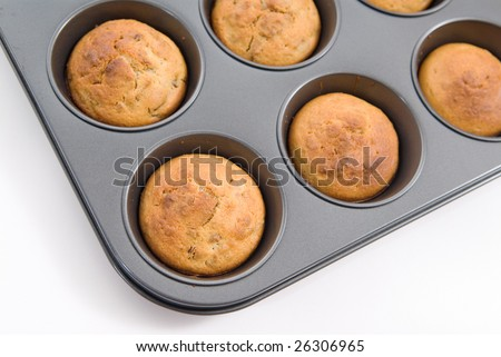 Oven fresh oatmeal and raisin muffins in baking tray