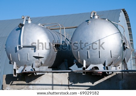 Oven fuel is stored in silvery tanks.