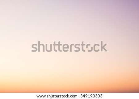 Over blur beautiful colorful sunset above sea and could sky texture background with boat and sun shine.