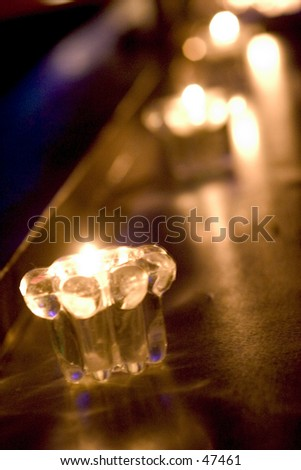 over exposed shot ofmultiple candles on a bar table top