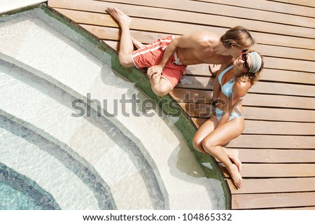 Over Head View Of An Attractive Couple Kissing While They Relax By A Swimming Pool 39 S Steps In A