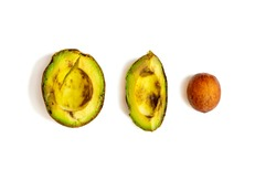 over-ripe, spoiled avocado on a white background