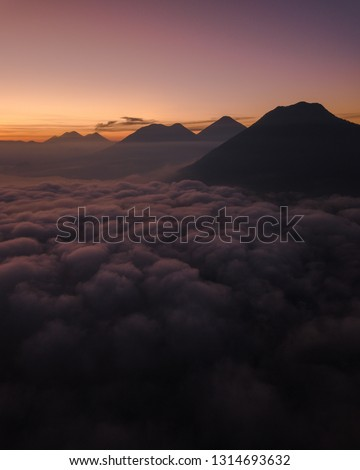 Over the clouds viewing volcanoes in Guatemala #1314693632