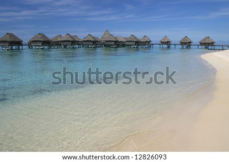 Over water bungalows at a Moorea resort. Island Moorea. French Polynesia