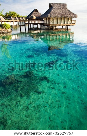 Over water bungalows over amazing lagoon with coral