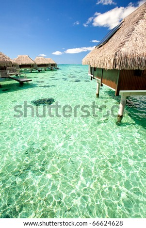 Over water bungalows over amazing tropical lagoon