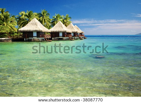 Over water bungalows with steps into amazing green lagoon #38087770
