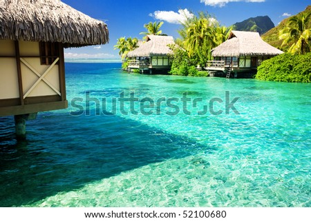 Over water bungalows with steps into amazing green lagoon #52100680