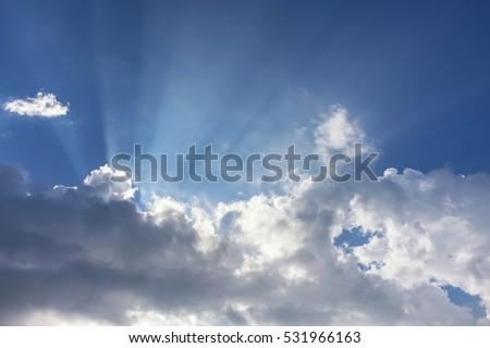 Overcast blue sky with sun beam,