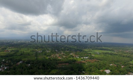 overcast in the sky during the rainy season and the village view from aerial drone camera #1436709440