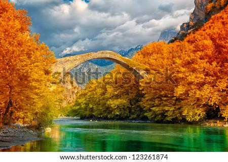 Overcast landscape of Konitsa bridge and Aoos River, Greece.