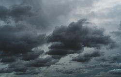 Overcast sky. Dramatic gray sky and white clouds before rain in rainy season. Cloudy and moody sky. Storm sky. Cloudscape. Gloomy and moody background. Overcast clouds. Halloween day background.