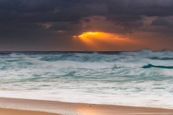 Overcast sunrise at the seaside from Birdie Beach on the Central Coast of NSW, Australia.