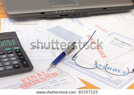 Overdue Bills with Calculator and Laptop
