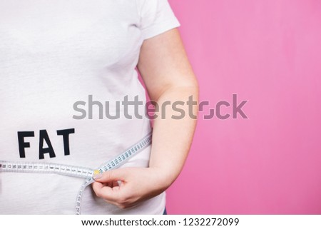 overeating, diet, glutton, diabetes, junk food. fat obese woman with big belly and measuring tape