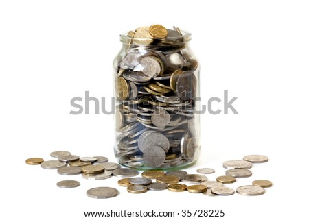 Overflowing jar of Australian coins, isolated on white.