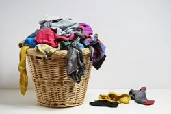 Overflowing laundry basket. Household chore concept on white background