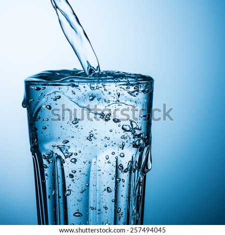 overflowing water in a glass ストックフォト ©