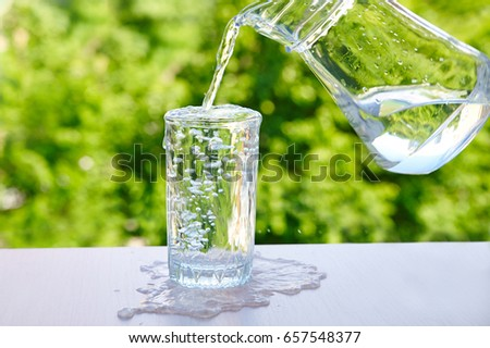 overflowing water in a glass Outdoors in summer ストックフォト ©