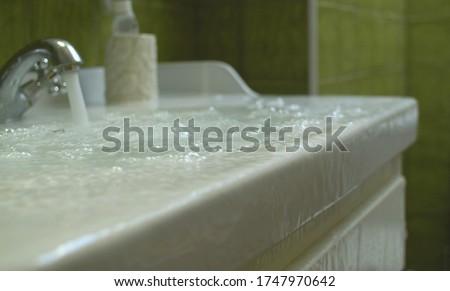 Overflowing water in the bathroom Stockfoto ©