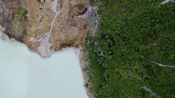 Overhead aerial view of glacier water Emerald Lake in the Andes mountains, Ushuaia, Tierra del Fuego, Patagonia Argentina. Turquoise color water lake surrounded by forest.