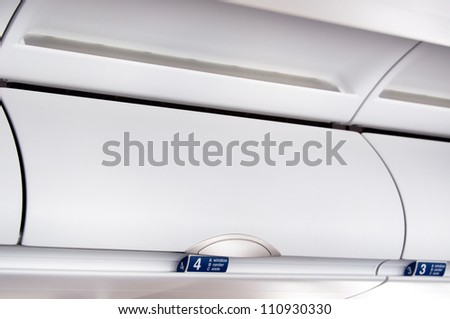 Overhead compartment - detail shot of an airplane cabin interior