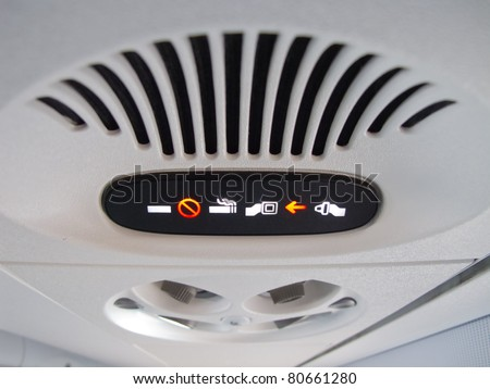 Overhead console in the modern passenger aircraft - stock photo