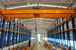 Overhead crane and concrete floor inside factory building for industrial background