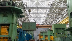 Overhead crane or bridge crane include hoist lifting for transportation, manufacturing, and production. Factory warehouse overhead crane lifts the load,