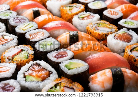 Overhead japanese sushi food. Maki ands rolls with tuna, salmon, shrimp, crab and avocado. Top view of assorted sushi, all you can eat menu. Rainbow sushi roll, uramaki, hosomaki and nigiri.