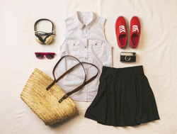 Overhead of essentials vintage woman. Outfit of casual woman.