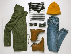 Overhead of hipster woman essentials. Outfit of casual woman.