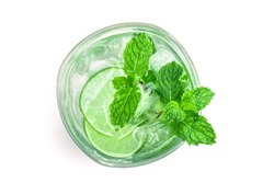 Overhead or top view shot of the fresh cool infused water of lime and mint or mojito cocktail look on white background