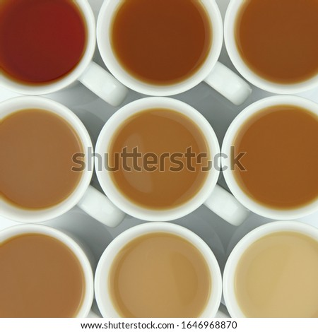Overhead photo of cups of tea of different strengths