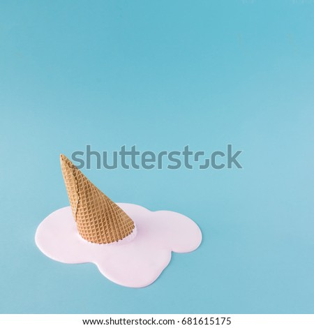Overhead pink ice cream on pastel blue background. Minimalistic summer food concept. #681615175