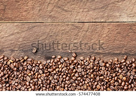 Shutterstock Overhead shot looking down on a flatlay image of coffee beans over a rustic wood table top background with copy space.