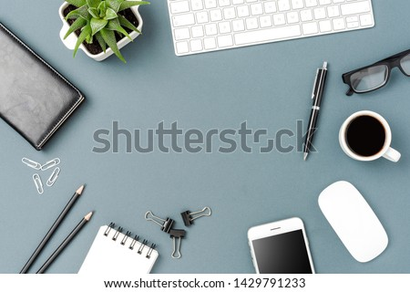 Overhead shot of business desktop with computer and mobile