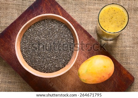 Overhead shot of chia seed (lat. Salvia hispanica) in bowl with mango and mango-chia juice photographed with natural light. Chia is considered a superfood with protein, omega fat, mineral, antioxidant