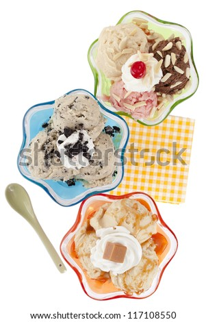 Overhead shot of flavorful ice cream on the cup on a white background