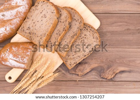 Overhead shot of fresh bread on wooden table #1307254207