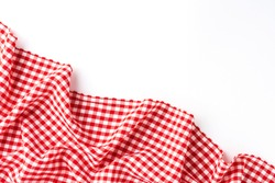 Overhead shot of red checkered table cloth with copyspace