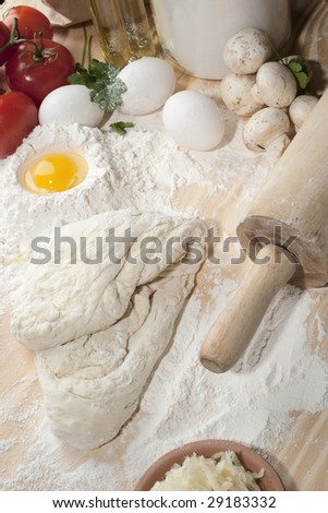 Overhead shot of table with dough and flour