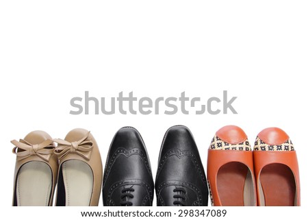 Overhead shot of three pairs of shoes, isolated on white background for copy space