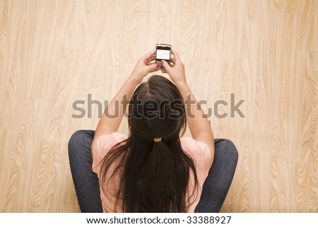 overhead shot of woman using a mobile device