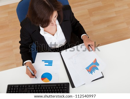 Overhead view of a businesswoman working in office