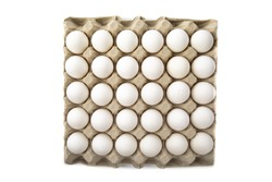 overhead view of a carton of 30 white eggs isolated on white