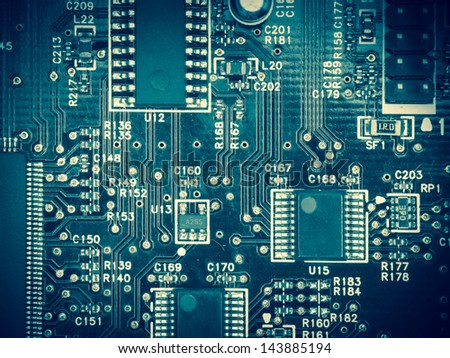 Overhead view of a circuit board, blue toning
