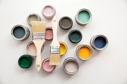 Overhead view of a DIY paint brush with colorful sample paint pots