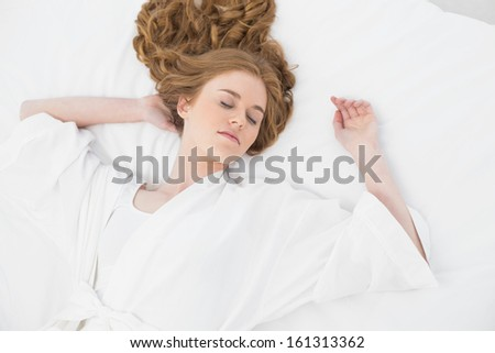 Overhead view of a pretty blond sleeping in bed at home